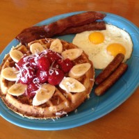 Coconut Waffles Full House with Bananas and Strawberries