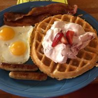 Coconut Waffles Full House with Strawberries and Cream